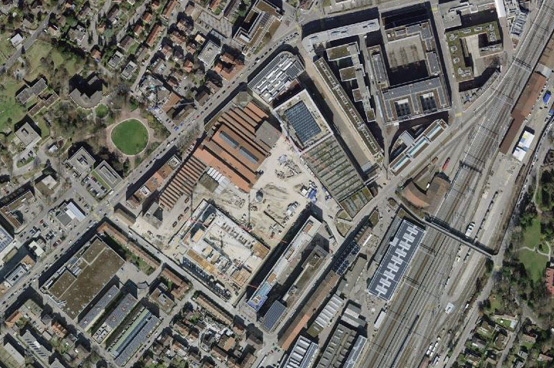 Aerial view of an industrial area under construction with large traffic axes.